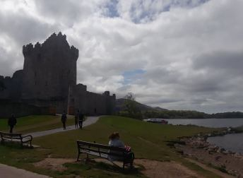 Ross Castle seated on the edge of a lake.