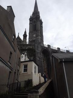 View of St. Colman's Cathedral from the climb halfway up the hill.