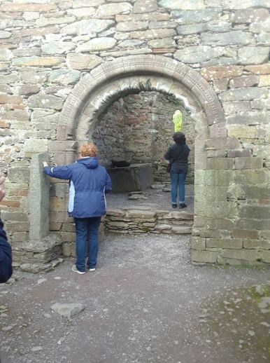 Entryway to Kilmalkedar Church, with an alphabet stone to the left.